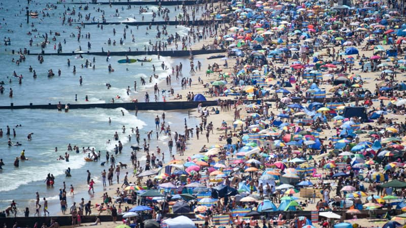 Scenes of crowded beaches over the summer, such as this at Bournemouth, helped stir local UK resentment against visitors.