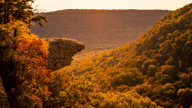 The sun rises over Whitaker Point, also known as Hawksbill Crag, in the Ozarks of Arkansas.