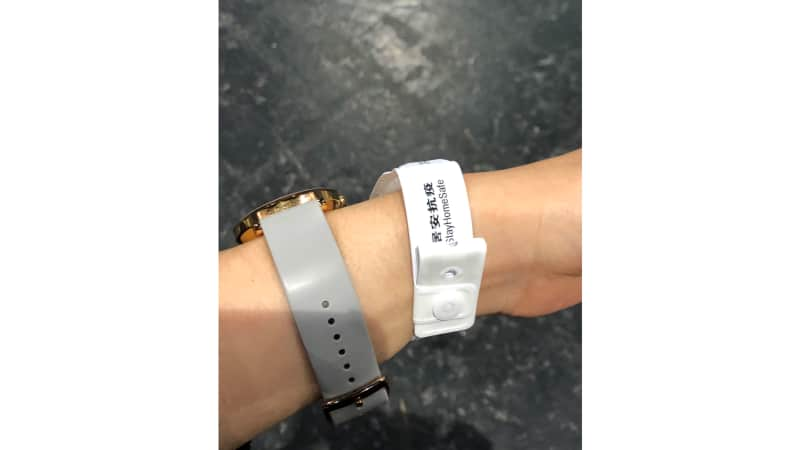 Upon landing in Hong Kong, Wang was required to put on this bracelet.