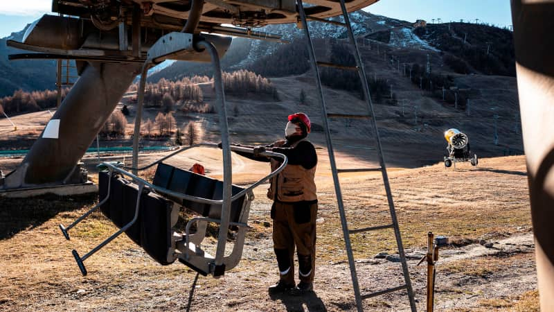 A maintenance man checks a chairlift at the alpine ski resort of Sestriere in Val Susa, Piedmont, Italy, on November 26, 2020
