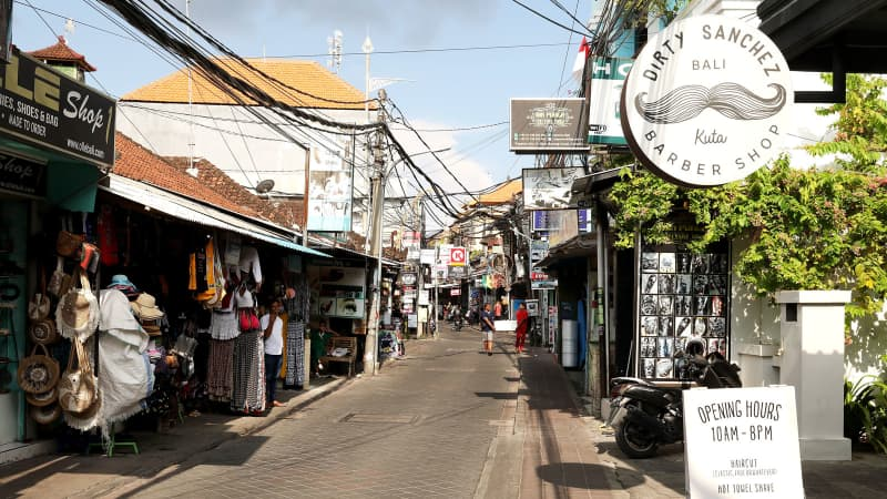 Local shops are seen in the near deserted Poppies Lane II at Kuta Beach on March 21, 2020 in Kuta, Indonesia.