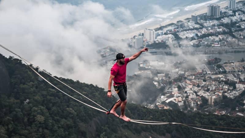 Here Robinson balances high above Rio de Janeiro, Brazil.