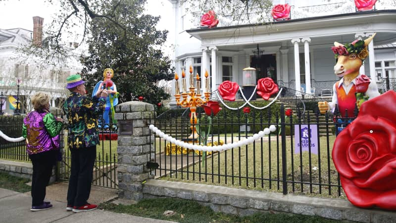 """People take pictures of house decorations on February 14, 2021. House """"floats"""" replaced parades this year."""