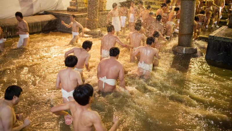 As part of the Naked Festival, participants purify themselves with freezing cold water before entering the main temple.