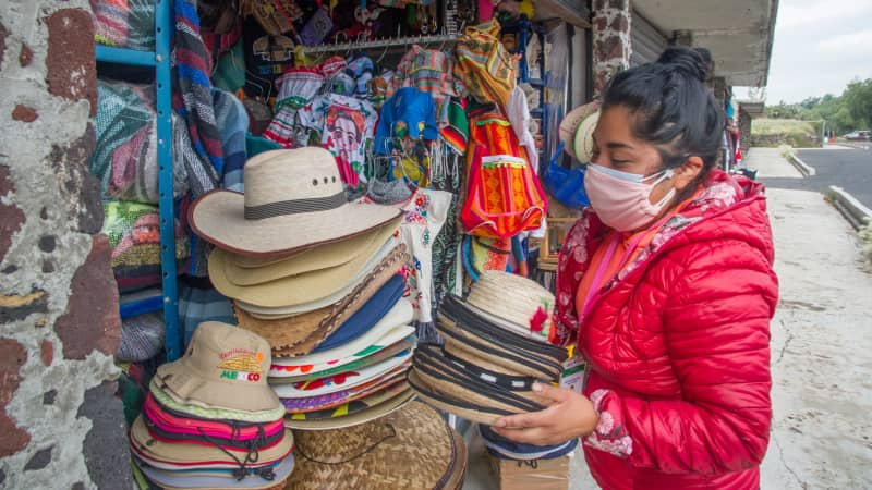 A handicrafts vendor puts hats on display at the archaeological site of Teotihuacan on September 10, 2020.