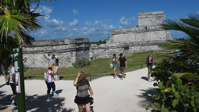 Tulum's archaeological ruins are a tourist draw on Mexico's Yucatan Peninsula. American and Canadian travel restrictions are eating into 2021's tourism high season.