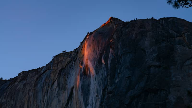 The rays of the setting sun create a pinkish-orange hue at firefall in Yosemite on Wednesday, February 24.