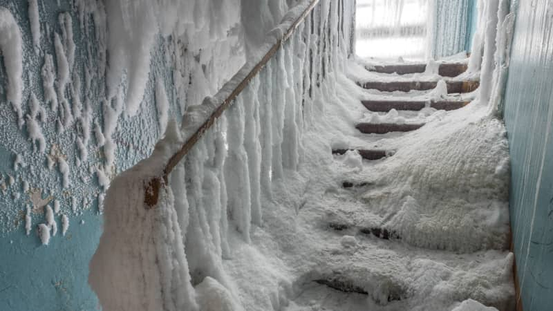 A staircase is frozen inside an abandoned building in the village of Severny.