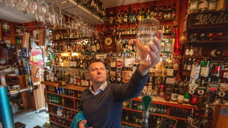 Publican Joe Sheridan poses for a photograph in his closed pub, Walsh's bar, in the Irish village of Dunmore in September 2020.