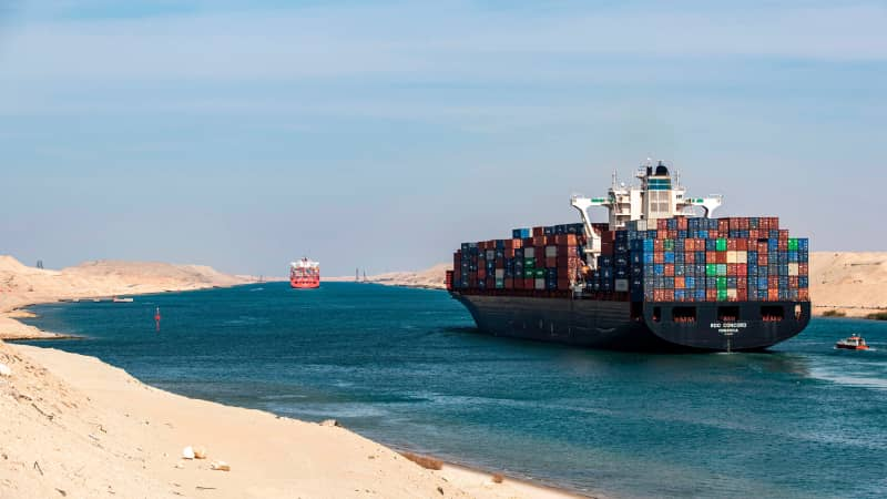 A container ship navigating the Suez Canal.