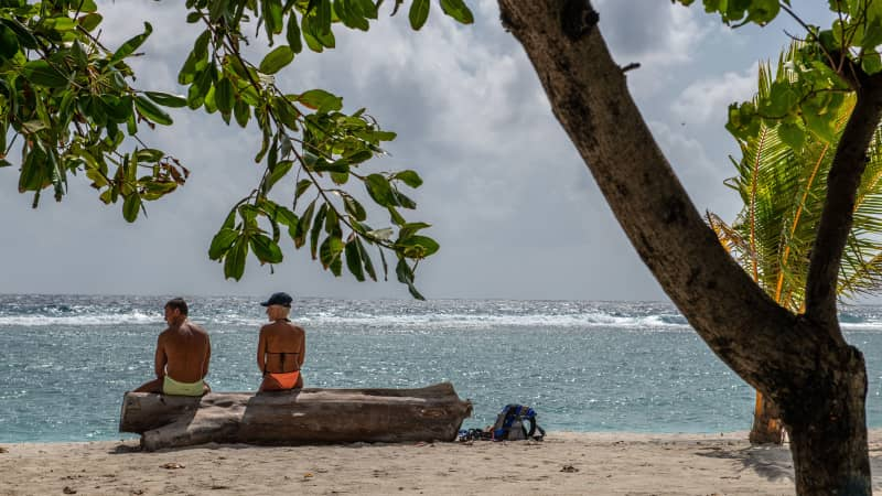 Tourists relax on the beach on Hulhumale, one of two artificial islands built up to 3 metres above sea level next to the capital city of Male
