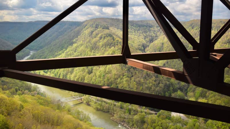 Up-close New River Gorge Bridge tours are available through Bridge Walk, a company that will safely harness visitors to the massive steel structure.