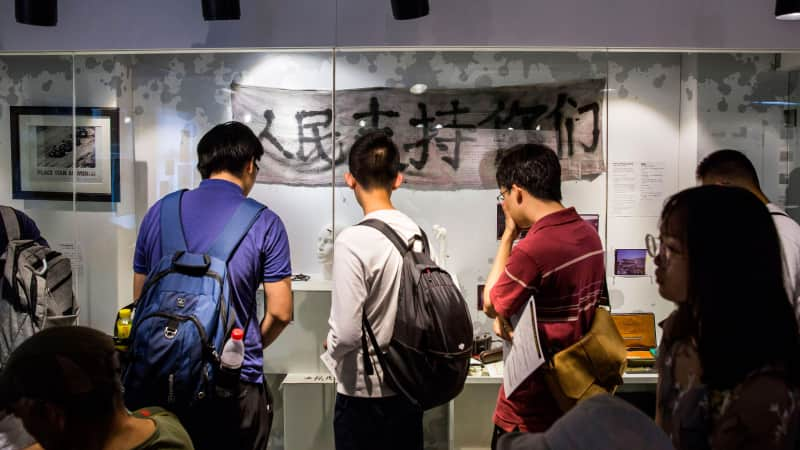 Visitors look at artefacts recovered from the scene of the 1989 Tiananmen Square crackdown on display at the June 4 Museum in Hong Kong on June 4, 2019.