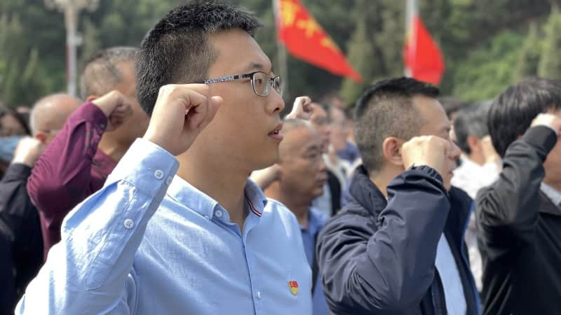 """Communist Party members re-take their admission oath in Xibaipo, a """"red site"""" near Beijing."""