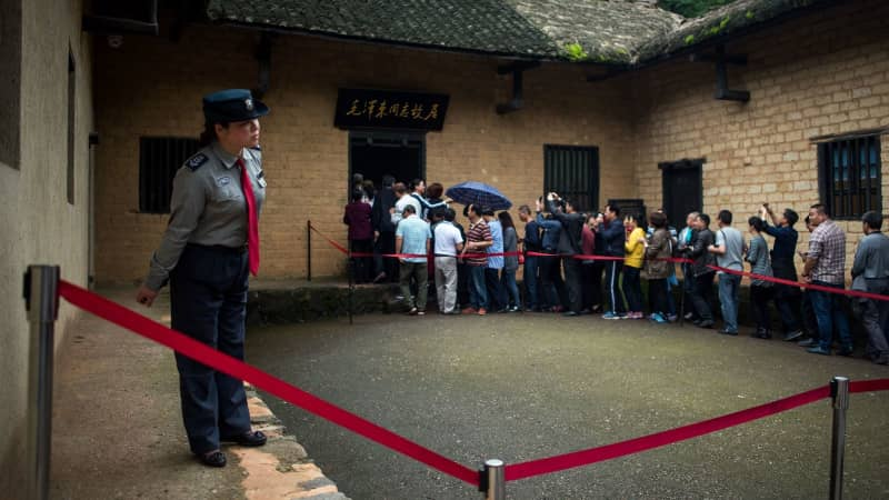 Tourists queue to enter the former residence of Communist leader Mao Zedong in 2016 in Shaoshan, in China's Hunan province.