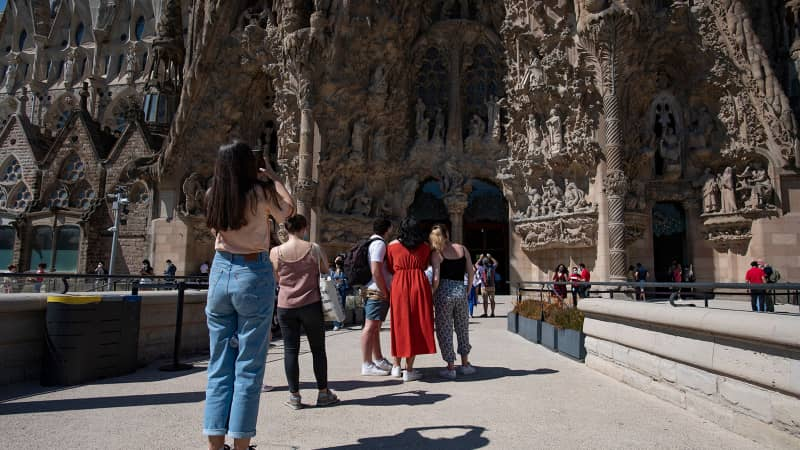 People visit the Sagrada Familia basilica in Barcelona on May 29, 2021. Spain plans to broaden entry to vaccinated travelers in June.