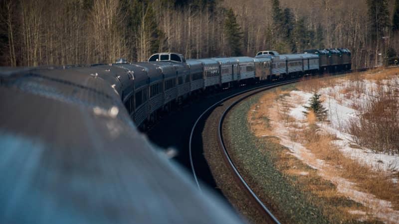 A Via Rail passenger train travels through Canada's Rocky Mountains.