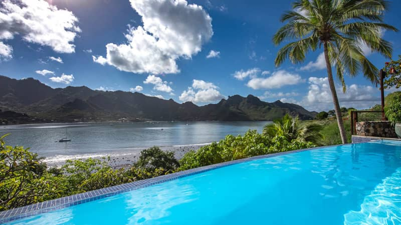 The infinity pool at Le Nuku Hiva by Pearl Resorts overlooks Taiohae Bay.