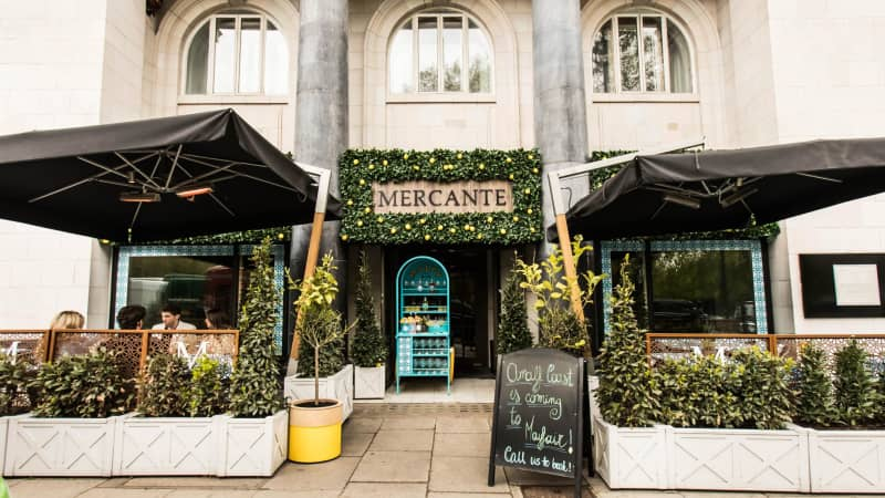 Mercante sits on the streets of London.