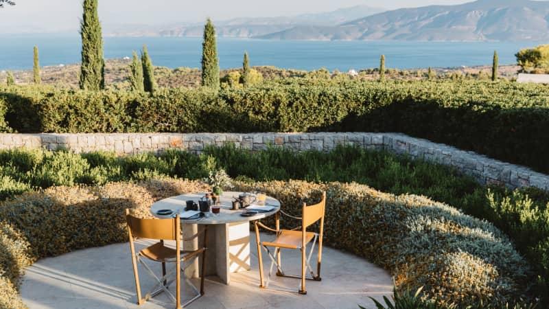 Amanzoe overlooks the shimmering blues of the Aegean Sea.
