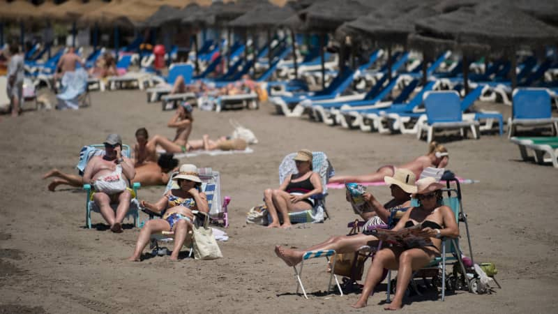 Tourists sunbathe at Marbella beach on June 7, 2021 in Marbella. - Spain opened its borders to vaccinated travellers from all over the world, hoping an influx of visitors will revitalise an all-important tourism sector that has been battered by the coronavirus pandemic. (Photo by JORGE GUERRERO / AFP) (Photo by JORGE GUERRERO/AFP via Getty Images)