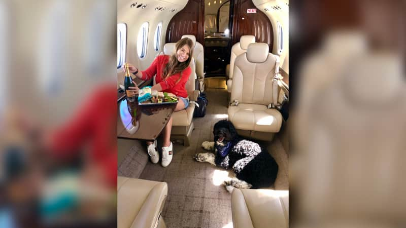 Katelynn Stege on board a private plane to New Jersey with her dog Moose.