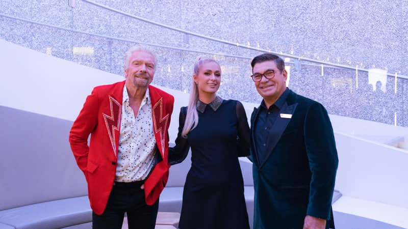 Richard Branson, Paris Hilton and Tom McAlpin at the Virgin Voyages Scarlet Lady Showcase in New York City.