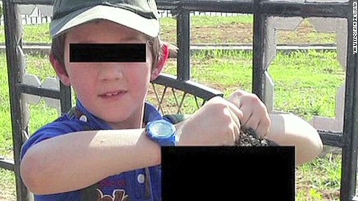 Wife: Father of boy shown holding severed head killed