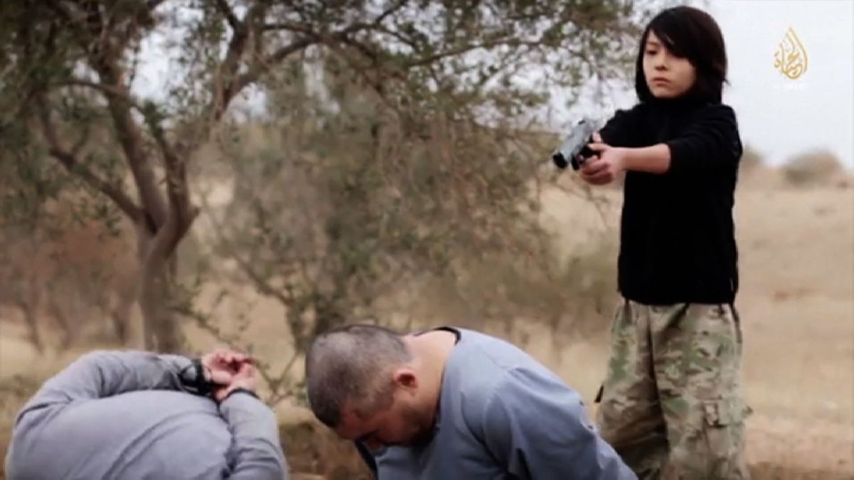ISIS claims video shows boy executing spies