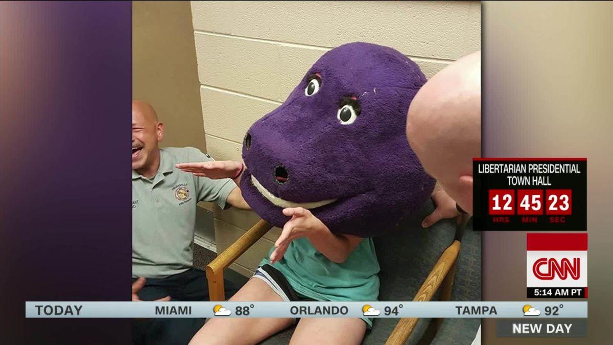 Teenager gets stuck in Barney head during prank - CNN