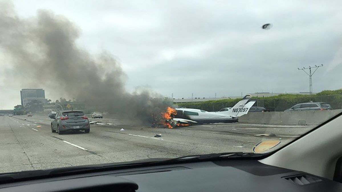 Driver hit by crashing plane, pulls fliers to safety - CNN