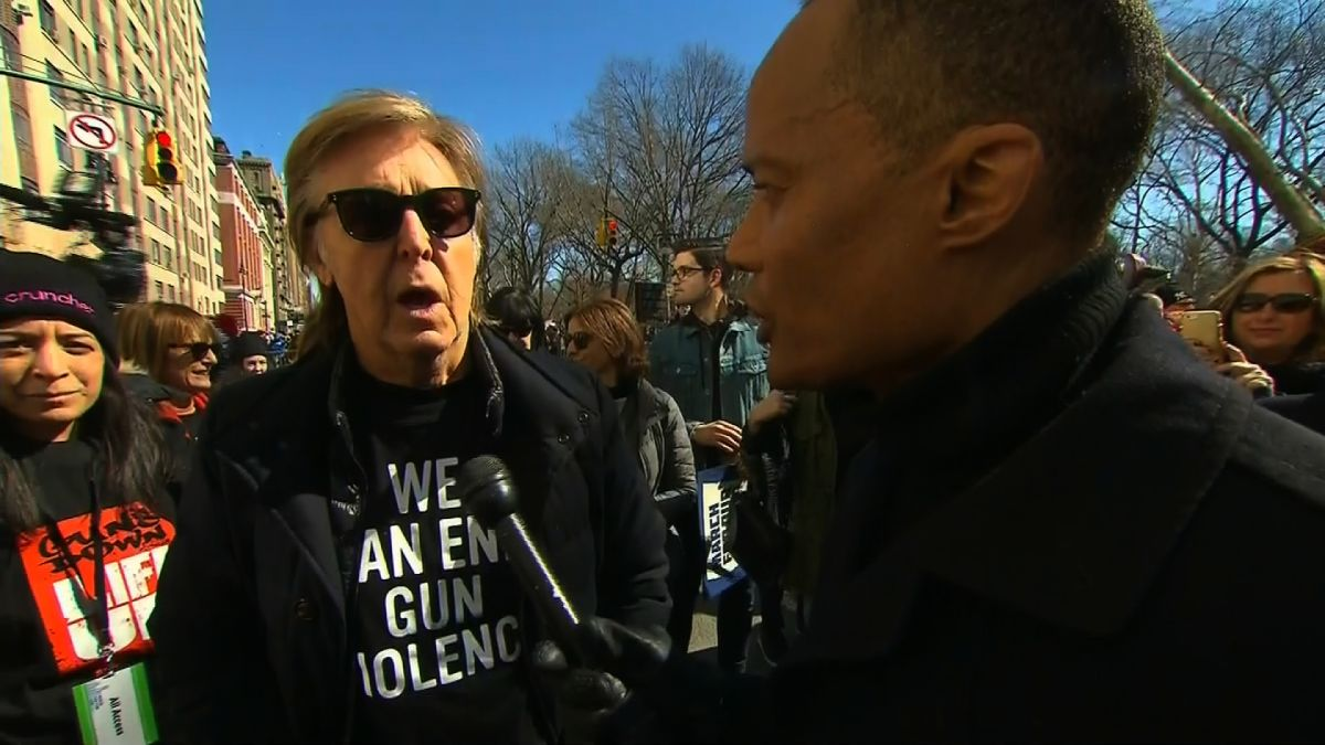 Image result for Paul McCartney was at the march in New York, close to the site where his friend John Lennon was shot to death