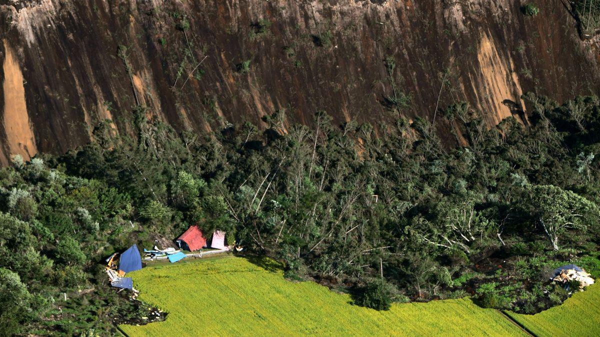 Japan earthquake buries homes under landslides - CNN Video