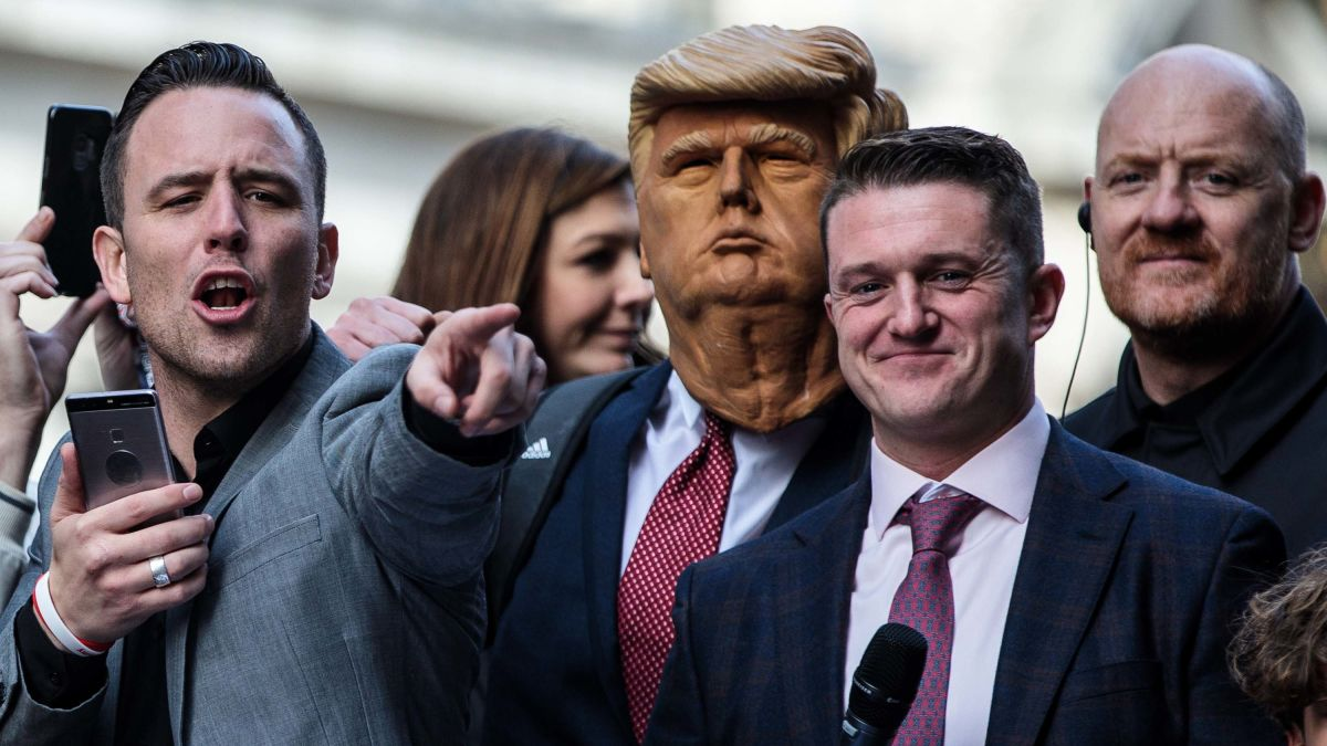UK far-right leader Tommy Robinson leaves London court and