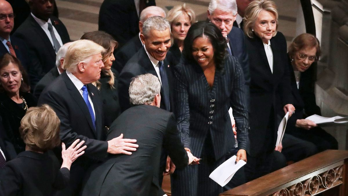 Image result for Michelle Obama and George W. Bush share a warm moment (and maybe a candy)