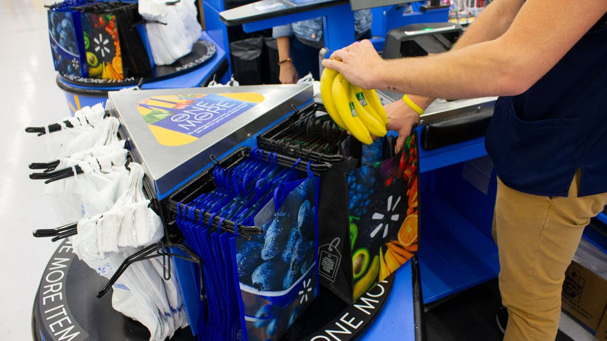 Walmart will sell 98¢ reusable bags at checkout carousels to