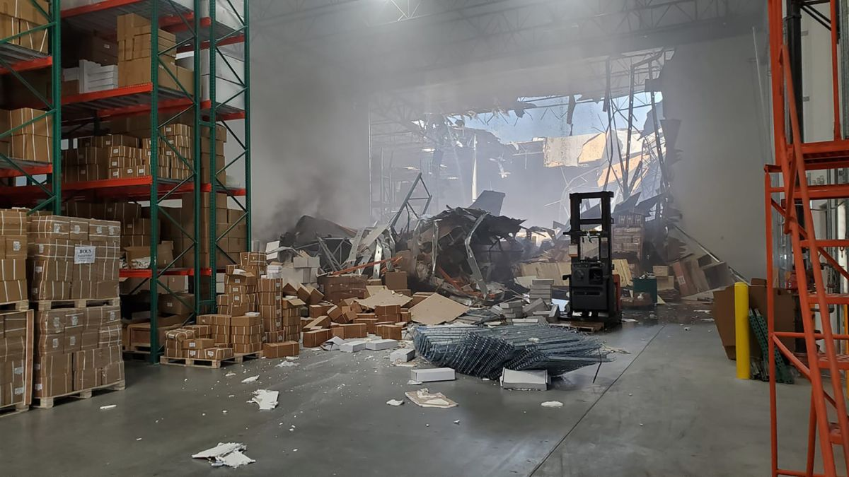F-16 fighter jet slams into warehouse