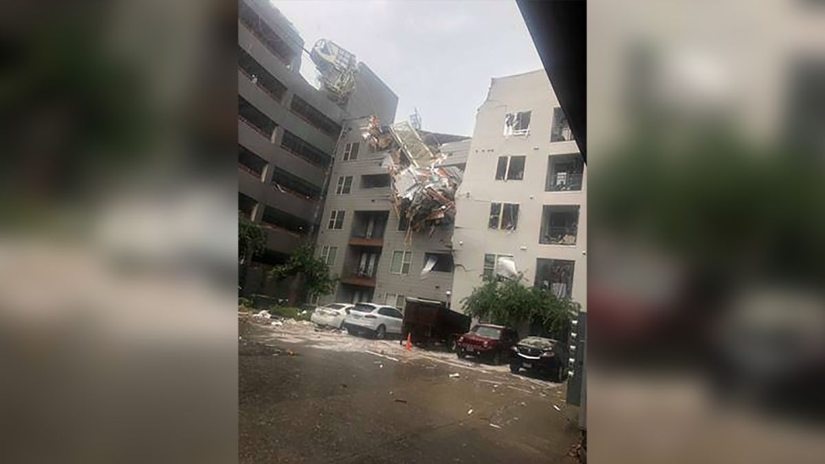 At least 1 person is dead and 6 others injured after crane falls on