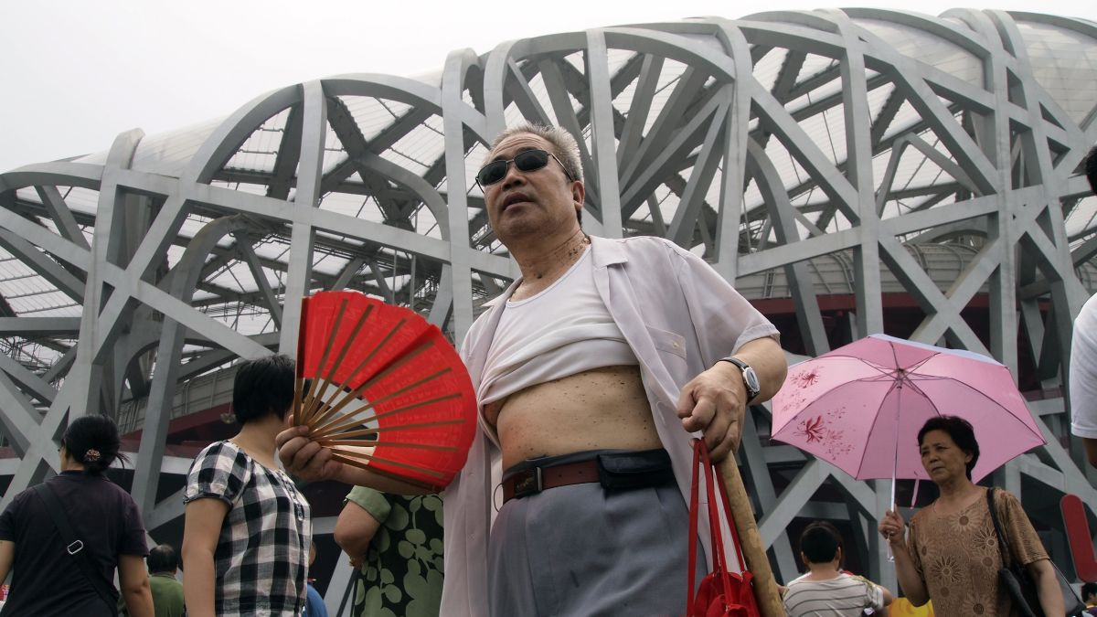 Image result for Each summer, as Chinese cities swelter under the baking heat, middle-aged men across the country roll their T-shirts up above their bellies to cool down.