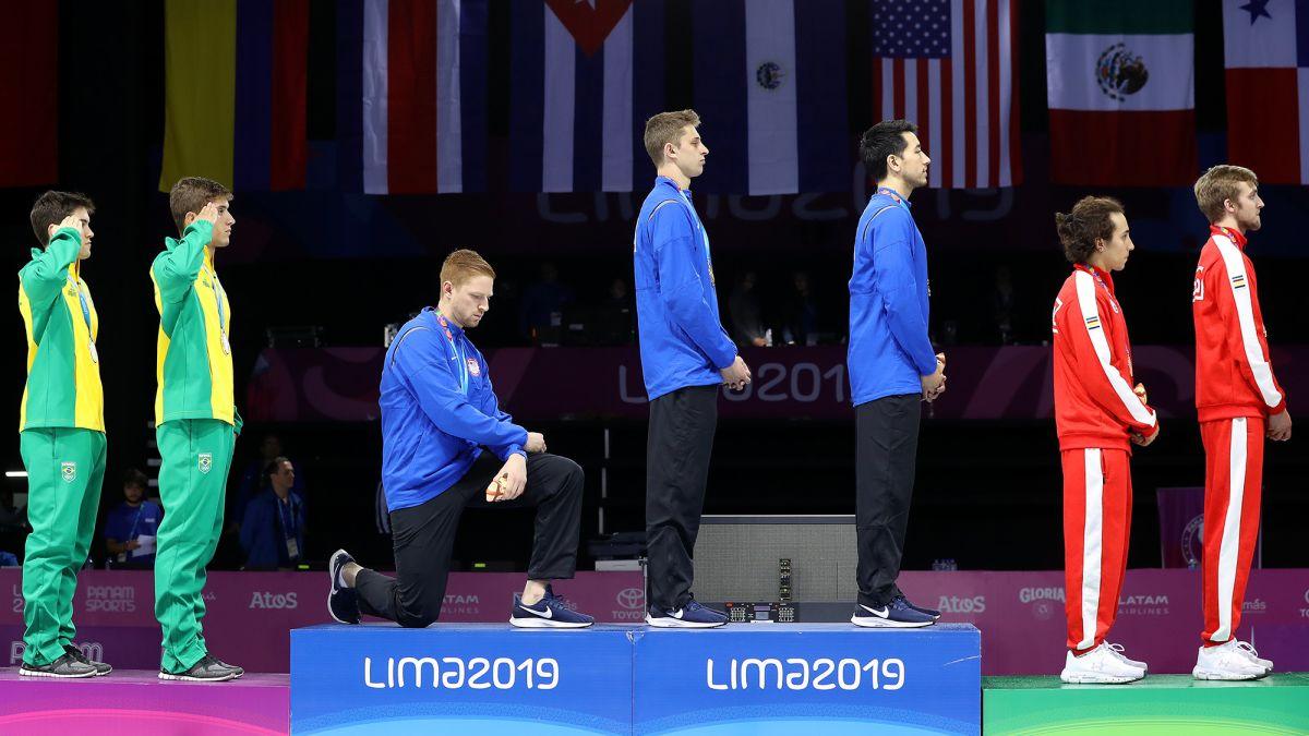 Gold medalist explains why he knelt during anthem