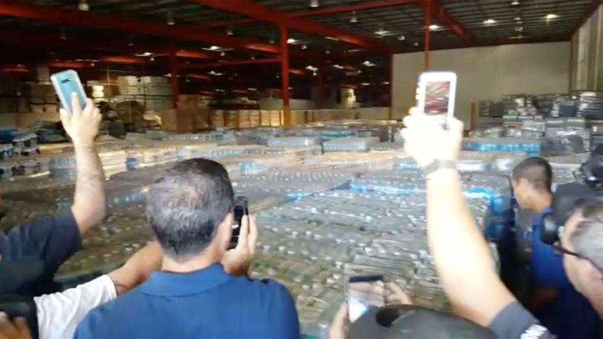 Image result for puerto ricans find water in warehouse