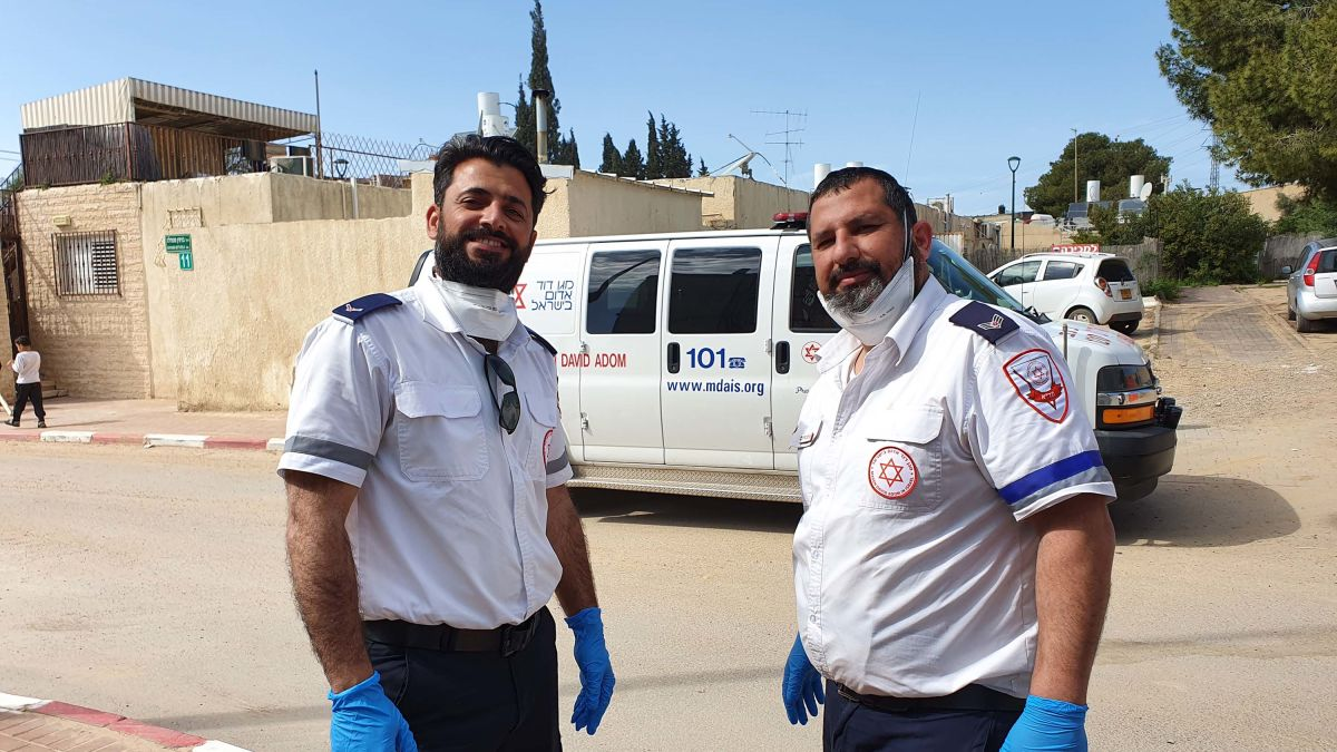 Muslim and Jewish paramedics pause to pray together. One of many ...