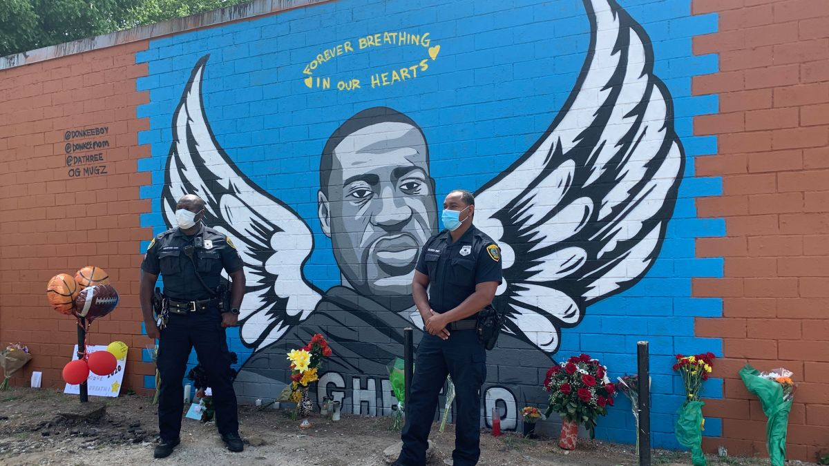 Houston police officers pay their respects to George Floyd at a ...