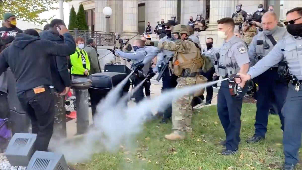 https://dynaimage.cdn.cnn.com/cnn/c_fill,g_auto,w_1200,h_675,ar_16:9/https%3A%2F%2Fcdn.cnn.com%2Fcnnnext%2Fdam%2Fassets%2F201031191439-nc-polls-march-police-pepper-spray.jpg