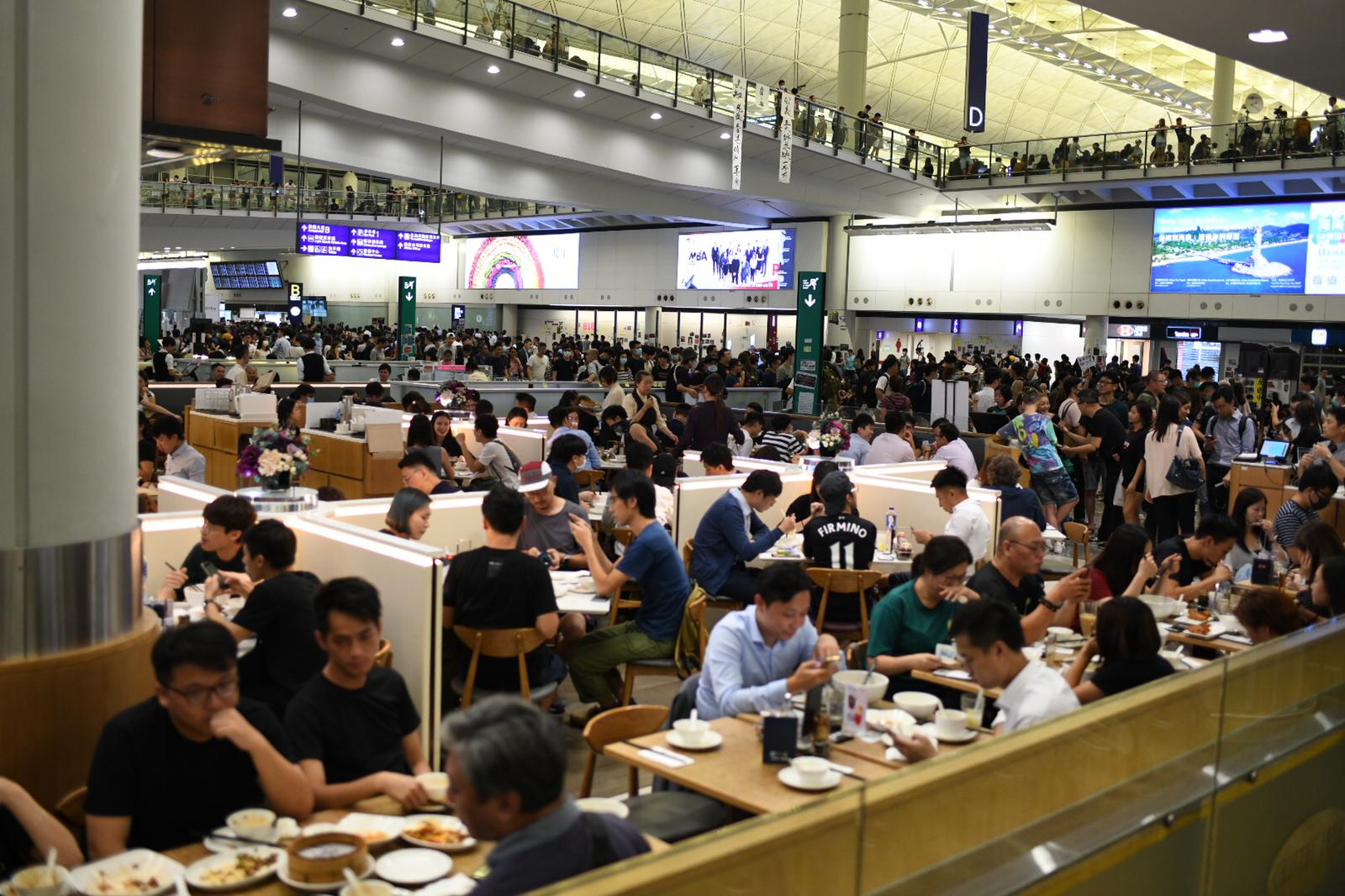 Customers pack the airport's restaurant which are open on the second night of airport disruption.