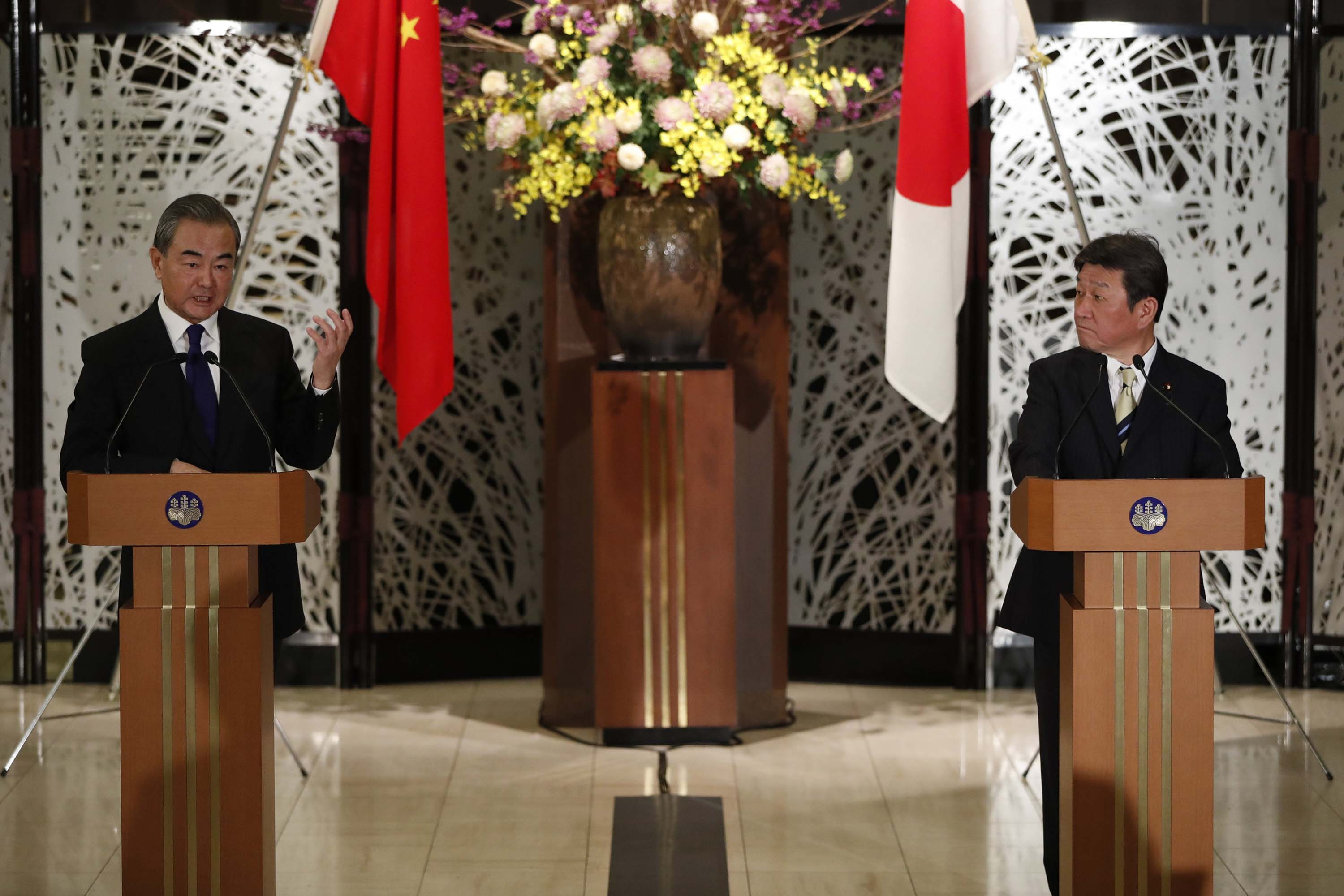 China's State Councillor and Foreign Minister Wang Yi, left, holds a joint press conference with his Japanese counterpart Toshimitsu Motegi after their meeting in Tokyo, Japan, on November 24.