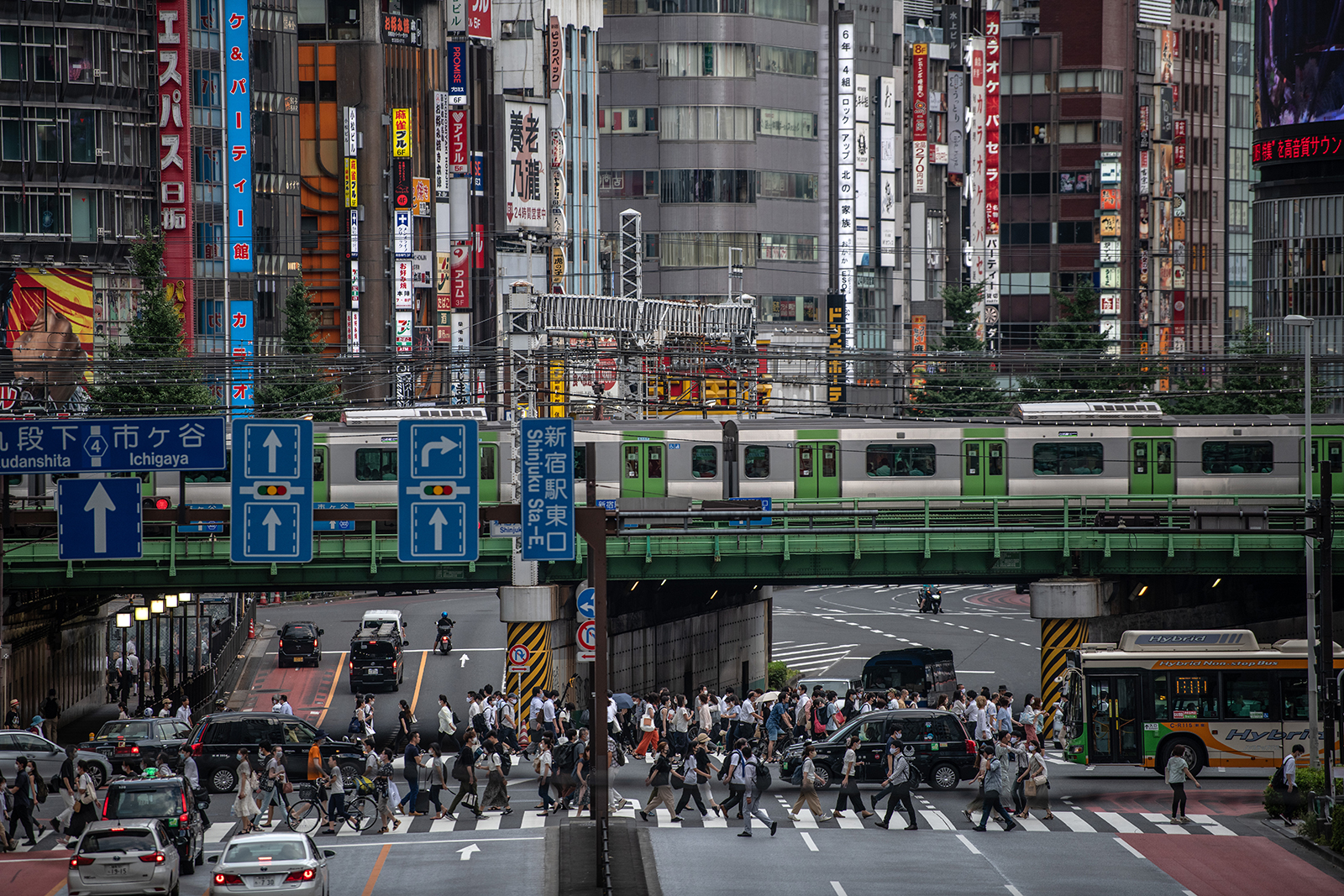 People cross a road in Tokyo, on August 17.