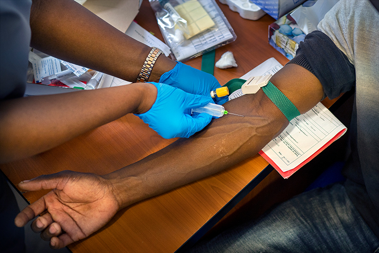 Blood is drawn from a clinical trials patient for the AstraZeneca test vaccine at the University of Witwatersrand' Soweto's Chris Sani Baragwanath Hospital facility outside Johannesburg on Nov. 30, 2020.