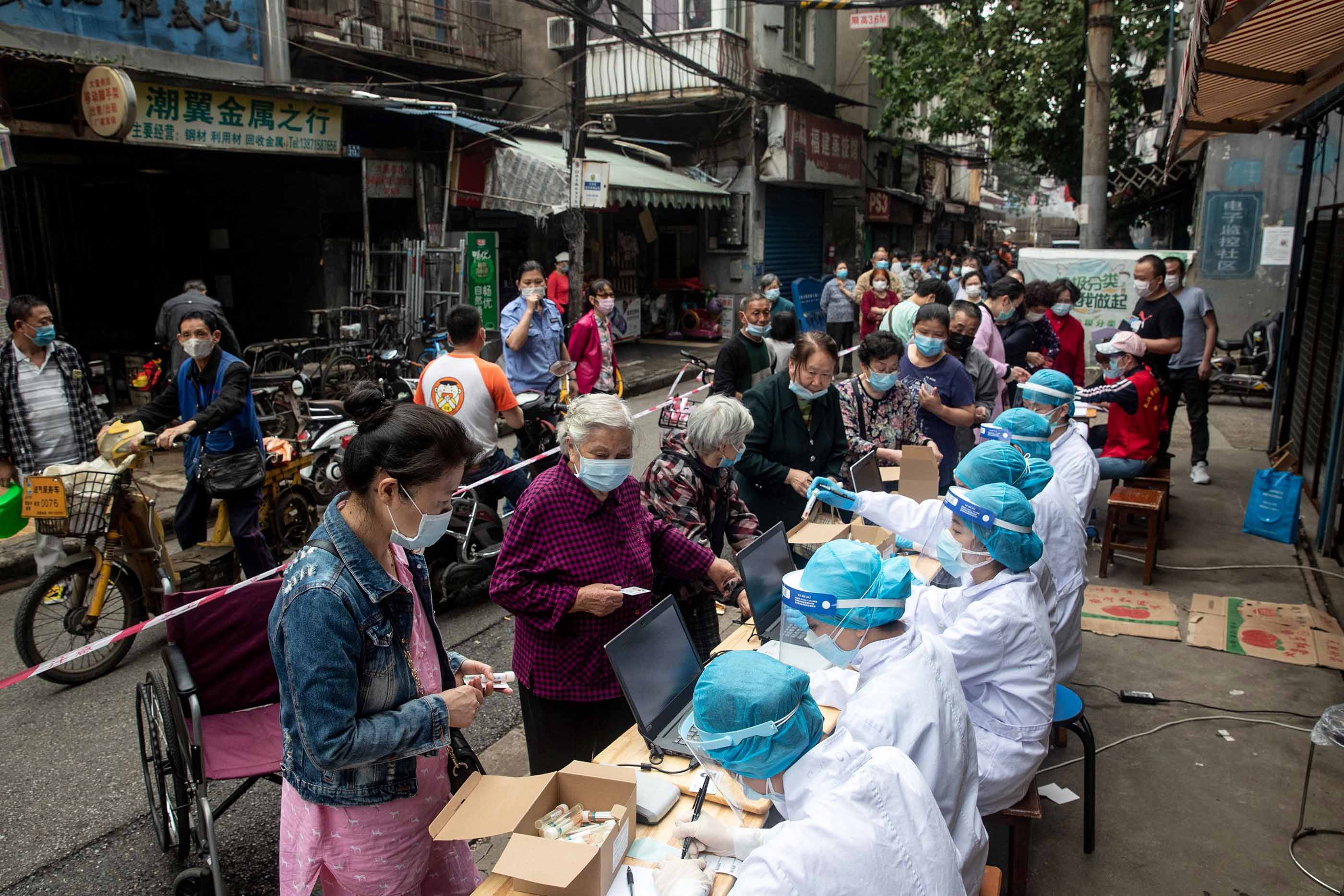 Wuhan residents register for coronavirus testing on May 15.