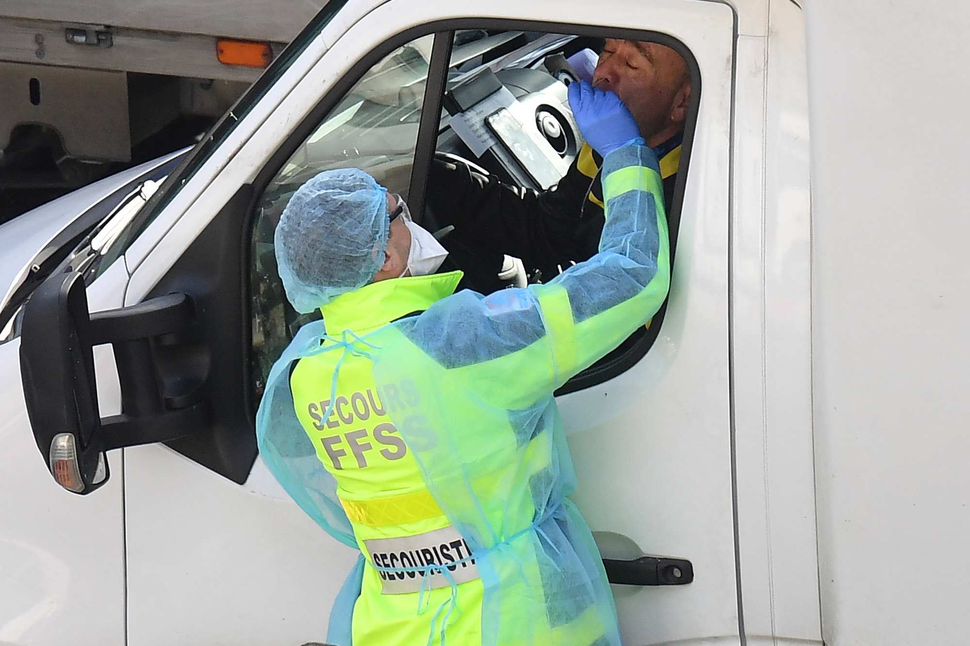 Members of the FFSS (French Federation of Rescue and First Aid) carry out covid-19 tests on lorry drivers close to the entrance to the Port of Dover, England, on December 24.